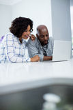 Happy couple using laptop Stock Photo