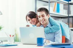 Happy couple using a laptop at home Royalty Free Stock Photo