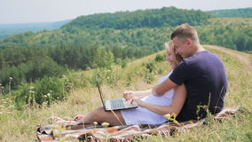 A happy couple using laptop stock footage