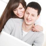 Happy Couple Using Laptop Stock Image