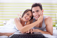 Happy couple using laptop Royalty Free Stock Image