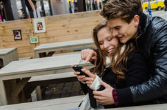 Happy Couple Using Mobile Phone Together Stock Image