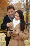 Happy couple using smartphone Stock Images