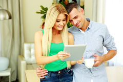 Happy couple using tablet computer Stock Photos