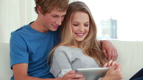 Happy couple using a tablet computer Stock Image