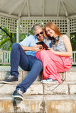 Happy couple using a tablet PC Stock Photos