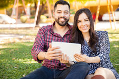 Happy couple using a tablet Stock Image