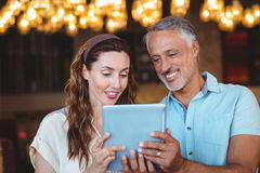 Happy couple using tablet together Stock Image
