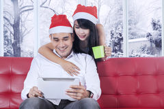 Happy couple using tablet together Stock Photos