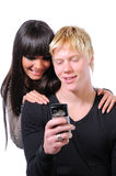 Happy couple using technology Royalty Free Stock Image