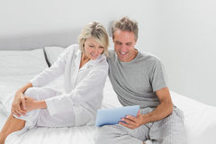 Happy couple using their digital tablet Stock Photo