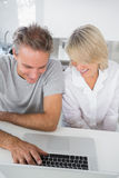 Happy couple using their laptop in the morning Stock Image