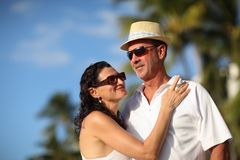 Happy couple on vacation. Happy mature adult couple enjoying vacation at tropical resort Stock Photos