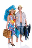 Happy couple, vacation. Attractive young couple in beach clothing, going on vacation.  Studio shot, white background, reflective surface Stock Photo