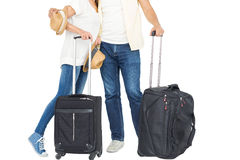 Happy couple in vacation with luggage. Against white background Stock Image