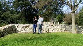 Happy couple in vacation in park walking romantic stock video footage