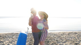 Happy couple on vacation, smiling at the beach. Travel concept stock footage