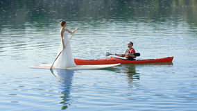 Happy couple on vacation sport kayak SUP newlyweds stock photo