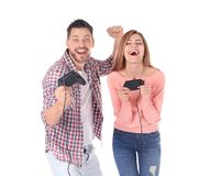 Happy couple with video game controllers. On white background Royalty Free Stock Image