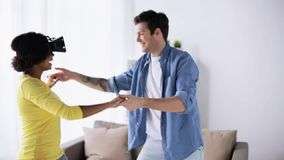 Happy couple with virtual reality headset at home stock video