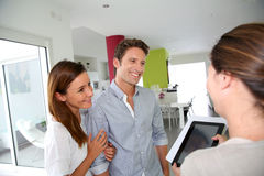 Happy couple visiting future home. Couple visiting home with real-estate agent Royalty Free Stock Image
