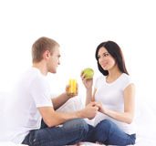 A happy couple waiting for the baby and eating healthy food Royalty Free Stock Photo