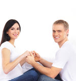 A happy couple waiting for the baby in white clothes Stock Image