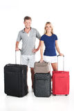 Happy couple waiting departure with luggage. Royalty Free Stock Photo