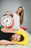 Happy couple waking up early Stock Images