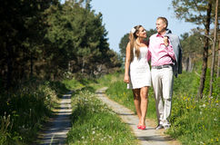 Happy couple walk. In the country, they talk happily stock images