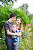 Happy couple on a walk in park Royalty Free Stock Photography