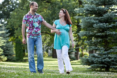 Happy couple walk in park Stock Images