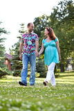 Happy couple walk in park Royalty Free Stock Photo