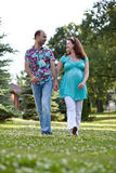 Happy couple walk in park Royalty Free Stock Photography