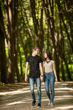 Happy couple in a walk in the park. Outdoor photo. Happy relationship Royalty Free Stock Photo