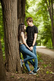 Happy couple in a walk in the park. Outdoor photo. Happy relationship Royalty Free Stock Image