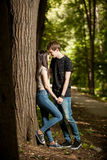 Happy couple in a walk in the park. Outdoor photo. Happy relationship Royalty Free Stock Photography