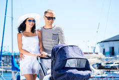 Happy couple walking with the baby outdoors Royalty Free Stock Image