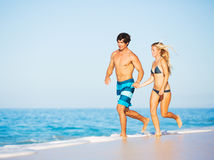 Happy Couple Walking on the Beach Royalty Free Stock Photos