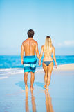 Happy Couple Walking on the Beach Stock Photography