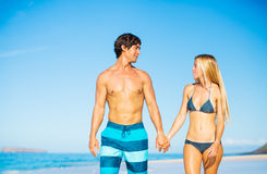 Happy Couple Walking on the Beach Stock Image