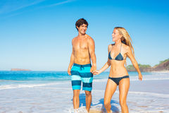 Happy Couple Walking on the Beach Royalty Free Stock Images