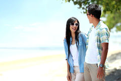 Happy couple walking by the beach Stock Photography