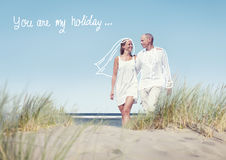 Happy Couple Walking on Beach with Quote Stock Photography