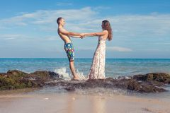Happy couple walking at the beach, sea view. Traveling at Bali. Honeymoon summer travel at Indonesia Royalty Free Stock Photos