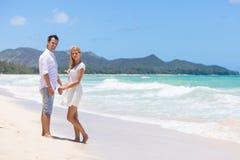 Happy couple walking on beach. Royalty Free Stock Image