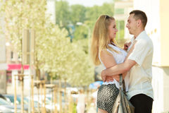 Happy couple walking in city enjoying romance Royalty Free Stock Photos