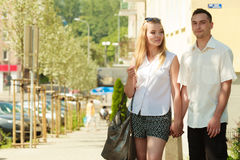 Happy couple walking in city enjoying romance Stock Image