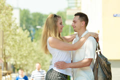 Happy couple walking in city enjoying romance Stock Photo