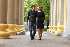 Happy couple walking in the city. Royalty Free Stock Photo